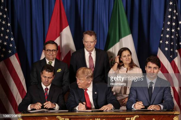 Enrique Pena Nieto Mexico's president from front left US president Donald Trump and Justin Trudeau Canada's prime minister sign the United...