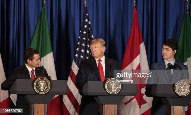 Enrique Pena Nieto Mexico's president left speaks as US president Donald Trump center and Justin Trudeau Canada's prime minister listen before the...