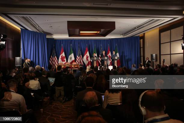 Enrique Pena Nieto Mexico's president left US president Donald Trump center and Justin Trudeau Canada's prime minister participate in a news...