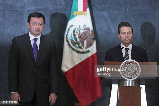 Enrique Pena Nieto Mexico's president right speaks as Miguel Angel Osorio Chong Mexico's minister of internal affairs listens during an announcement...