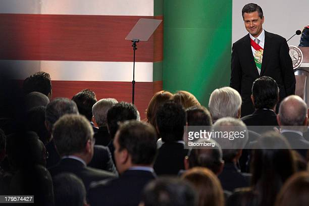 Enrique Pena Nieto Mexico's president smiles following his first state of the nation address in Mexico City Mexico on Monday Sept 2 2013 Pena Nieto...