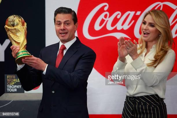 Enrique Pena Nieto President of Mexico and his wife Angelica Rivera de Pena attend during the FIFA Trophy Tour at Residencia Oficial de Los Pinos on...