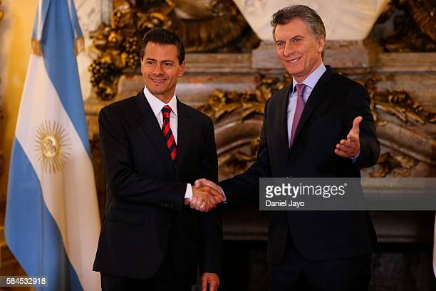 Enrique Pena Nieto president of Mexico and Mauricio Macri president of Argentina shake hands during an official visit to Argentina at Casa Rosada on...