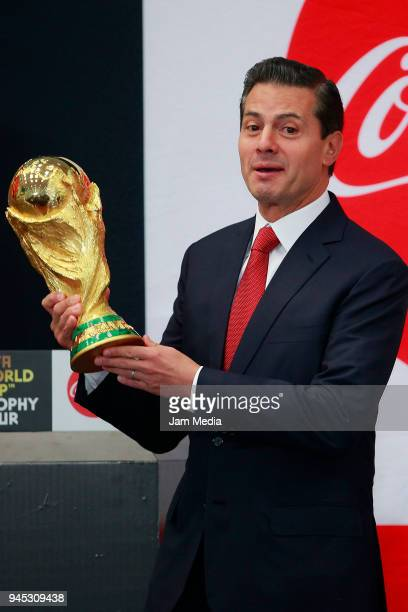 Enrique Pena Nieto President of Mexicoholds the FIFA Trophy during the FIFA Trophy Tour at Residencia Oficial de Los Pinos on April 11 2018 in Mexico...