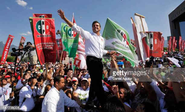 Enrique Pena Nieto presidential candidate for the Institutional Revolutionary Party waves during his final campaign rally on June 27 2012 in...