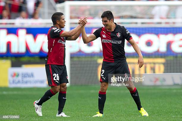Enrique Perez of Atlas celebrates after scoring the opening goal against Chivas during a match between Chivas and Atlas as part of 12th round...