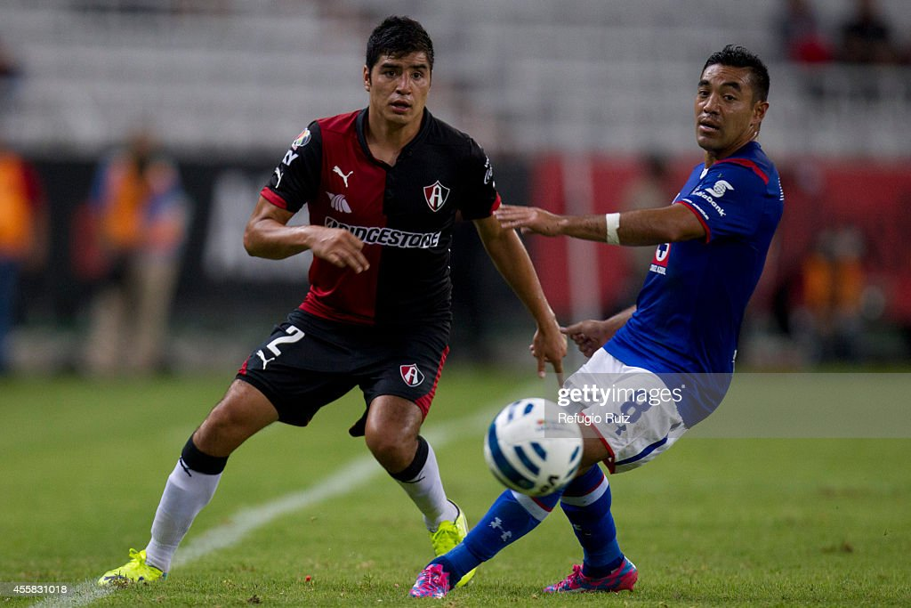 Enrique Perez of Atlas (L) fights for the ball with Marco Fabian of Cruz Azul during a match between Atlas and Cruz Azul as part of 9th round Apertura 2014 Liga MX at Jalisco Stadium on September 20, 2014 in Guadalajara, Mexico.