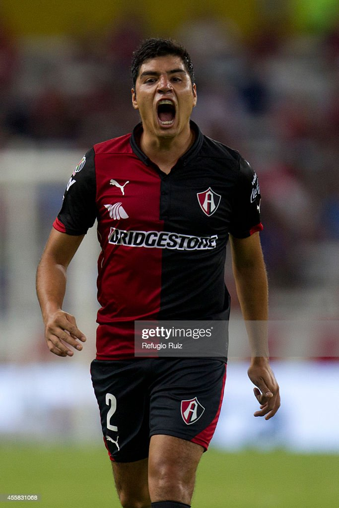 Enrique Perez of Atlas gives instructions to his partners during a match between Atlas and Cruz Azul as part of 9th round Apertura 2014 Liga MX at Jalisco Stadium on September 20, 2014 in Guadalajara, Mexico.