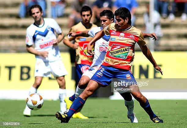 Enrique Perez of Monarcas Morelia vies for the ball with Oswaldo Martinez of Monterrey during their match as part of the Apertura 2010 at Morelos...