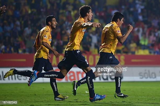 Enrique Perez of Morelia celebrates score a goal during a match between Morelia and Puebla as part of the Apertura 2013 Liga MX at Morelos Stadium on...