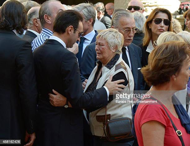Enrique Ponce and Angela attend the funeral for the Spanish bullfighter Jose Maria Manzanares at Cathedral of San Nicolas on October 30 2014 in...