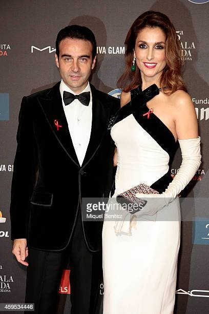 Enrique Ponce and Paloma Cuevas pose during a photocall for 'Fifth Gala Against HIV 2014' at the Museu Nacional d'Art de Catalunya on November 24...