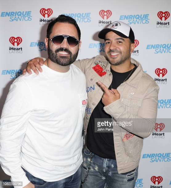 Enrique Santos and Luis Fonsi at The Enrique Santos Show At I Heart Latino Studios on October 15 2018 in Miramar Florida