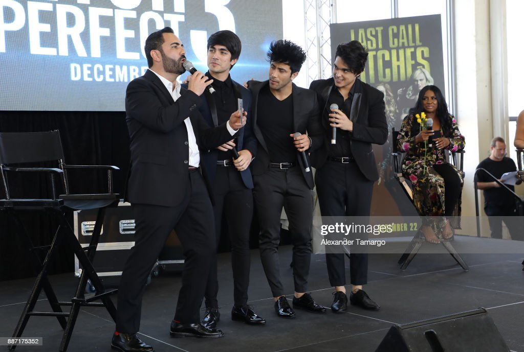 Enrique Santos and musical group Angeles are seen at SLAM! Academy of Miami during the Pitch Perfect 3 special event on December 6, 2017 in Miami, Florida.