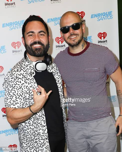 Enrique Santos and Rene Perez Joglar 'Residente' pose together during his visit at The 'Enrique Santos Show' At The I Heart Latino Studio on April 17...