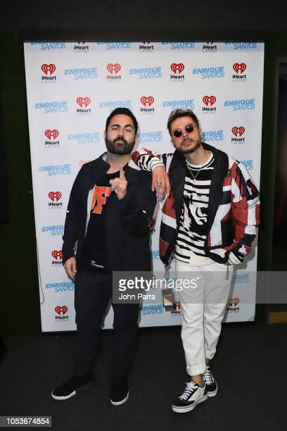 Enrique Santos and Reykon are seen at The Enrique Santos Show At I Heart Latino Studios at I Heart Latino Studios on October 25 2018 in Miramar...