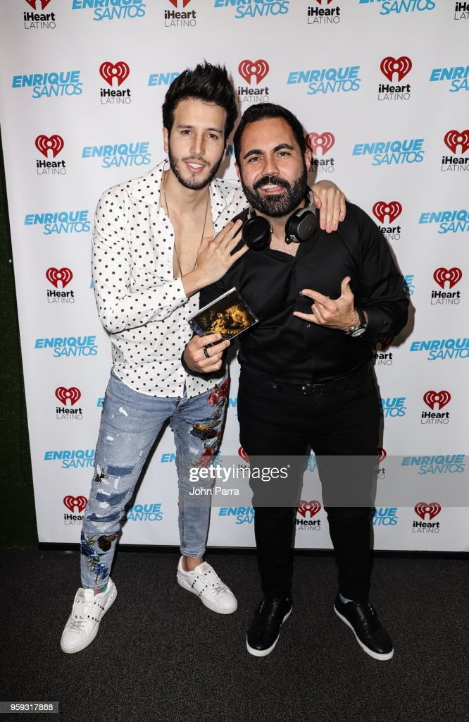 Enrique Santos and Sebastian Yatra are seen at 'The Enrique Santos Show' at I Heart Latino Studios on May 16, 2018 in Miramar, Florida.