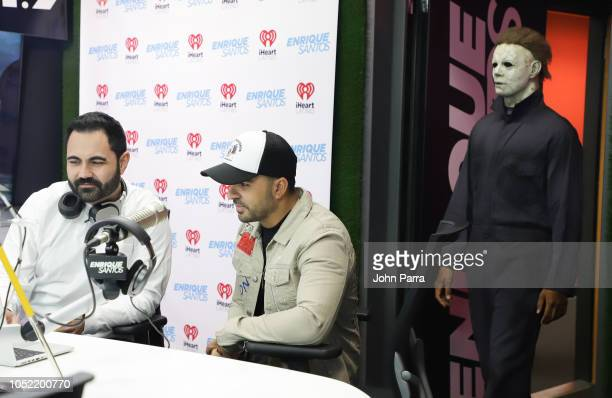 Enrique Santos Luis Fonsi and Michael Myers visit The Enrique Santos Show At I Heart Latino Studios on October 15 2018 in Miramar Florida