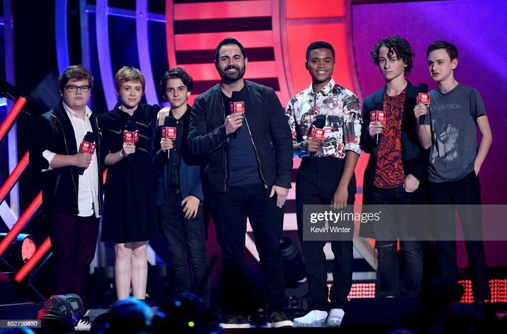 Enrique Santos (C) with (L-R) Jeremy Ray Taylor, Sophia Lillis, Jack Dylan Grazer, Chosen Jacobs, Wyatt Oleff, and Jaeden Lieberher speak onstage at the 2017 iHeartRadio Music Festival at T-Mobile Arena on September 23, 2017 in Las Vegas, Nevada.