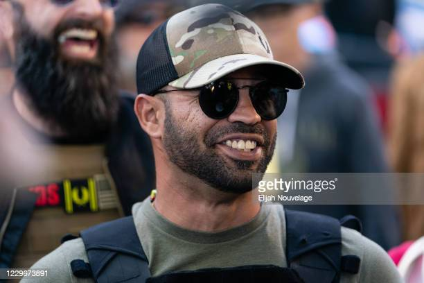 """Enrique Tarrio, leader of the Proud Boys, a far-right group, is seen at a """"Stop the Steal"""" rally against the results of the U.S. Presidential..."""