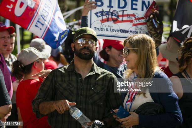 Enrique Tarrio, leader of the Proud Boys is seen outside the Hyatt Regency Hotel during Conservative Political Action Conference, in Orlando,...
