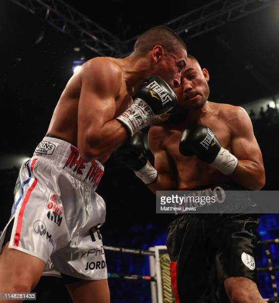Enrique Tinoco of Mexico in action against Jordan Gill of England during the WBA International Featherweight Championship fight during the JD NXTGEN...