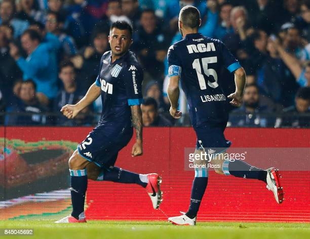 Enrique Triverio of Racing Club celebrates with teammate Lisandro Lopez after scoring the first goal of his team during a match between Racing Club...