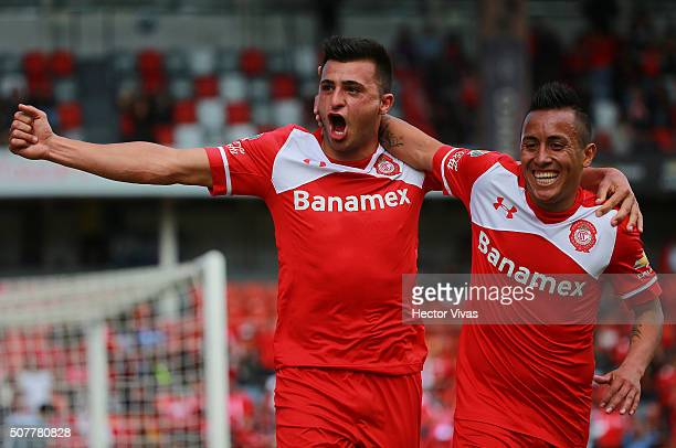 Enrique Triverio of Toluca celebrate with his teammate after scoring the first goal of his team during the fourth round match between Toluca and...