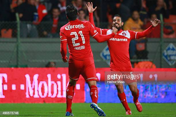 Enrique Triverio of Toluca celebrates with Oscar Ricardo Rojas after scoring the first goal of his team during the 11th round match between Toluca...