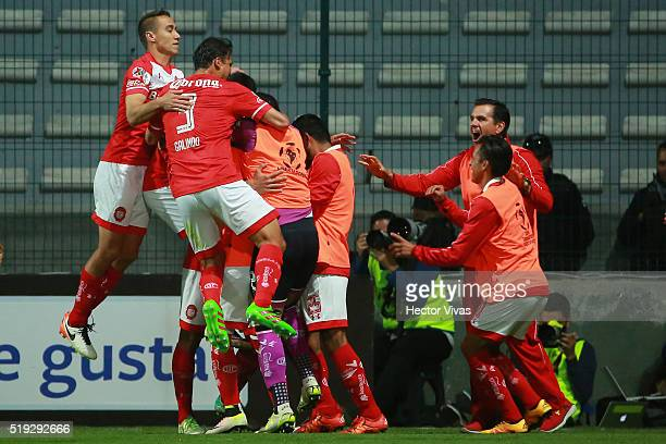 Enrique Triverio of Toluca celebrates with teammates after scoring the second goal of his team during a match between Toluca and LDU Quito as part of...