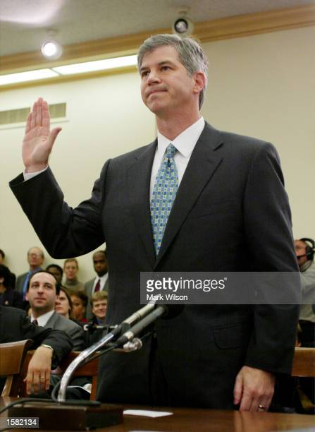 Enron's former Chief Financial officer Andrew S Fastow raises his right hand as he is sworn in before the House Energy and Commerce oversight and...