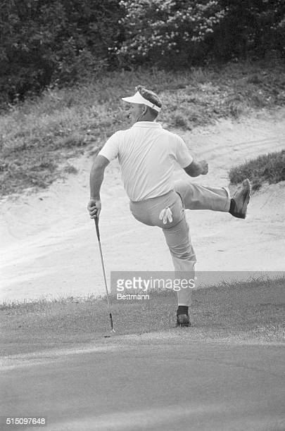 Enroute to his fourth Master's championship Arnold Palmer tries to kick an 80 foot shot into the 12th hole It didn't work but Arnie went on to come...
