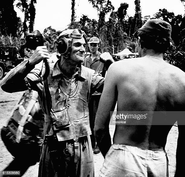 Ens Andy Jagger a pilot of the Navy's VF17 squadron tells Lt H A March about an air battle over Rabaul on Bougainville February 1944