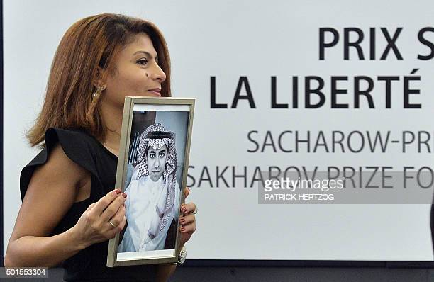 Ensaf Haidar holds a picture of her husband Raif Badawi after accepting the European Parliament's Sakharov human rights prize on behalf of her...