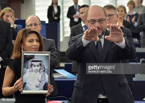 Ensaf Haidar holds a picture of her husband Raif Badawi next to European Parliament president Martin Schulz after accepting the European Parliament's...