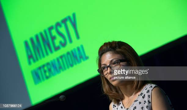 Ensaf Haidar the wife of jailed Saudi blogger Raif Badawi holds a speech as a guest at the annual meeting of the German section of Amnesty...