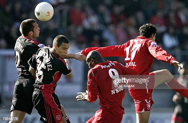 Ajaxplayers' Gregory van der Wiel and John Heitinga in duel with FC Twente ' Blaise N'Kufo and teammate Otman Bakkall 11 March 2007 as part of the...
