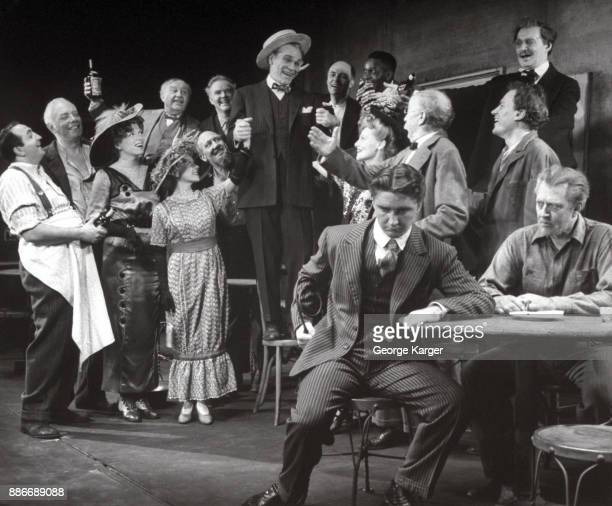Ensemble scene from a performance of Eugene O'Neill's 'The Iceman Cometh' Martin Beck Theatre New York 1946 Actor James Barton stands on a chair in...