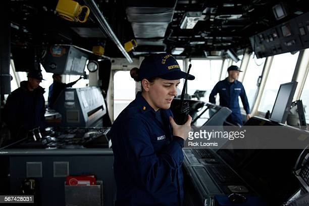 BARROW ALASKA –– SEPTEMBER 1 2012 –– Ensign Hayley Warshauer officer of the deck speaks into a hand–held radio from the bridge of the Bertholf a US...