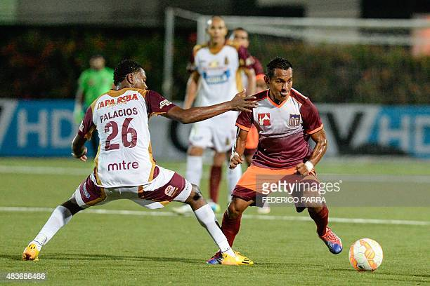 Enson Rodriguez of Venezuela's Carabobo FC vies for ball with Nicolas Palacios of Colombias Tolima during their Copa Sudamericana 2015 football match...