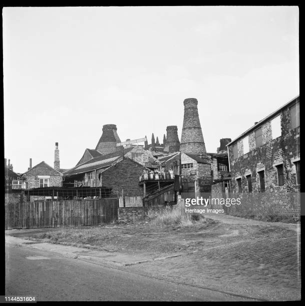 Enson Works, Bagnall Street, Longton, Stoke-on-Trent, 1965-1968. The bottle kilns of Enson Works viewed from the entrance to Short Street with...