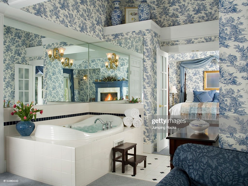 Ensuite Bathroom With Blue Toile De Jouy Wallpaper And View To Bedroom.