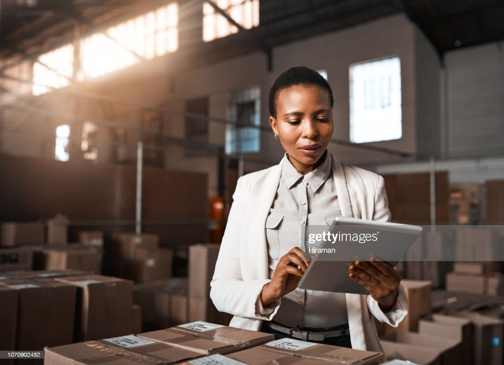 Ensuring all factory operations are running as they should be : Stock Photo