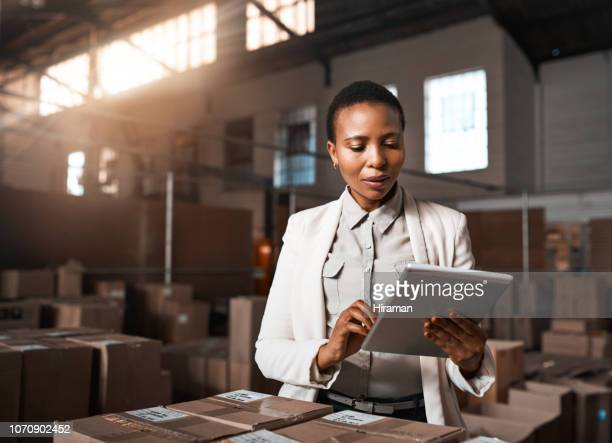 ensuring all factory operations are running as they should be - african ethnicity stock pictures, royalty-free photos & images