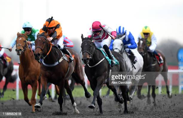 Entangling ridden by William Carson wins the Matchbook Betting Podcast Handicap at Kempton Park on November 19, 2019 in Sunbury, England.