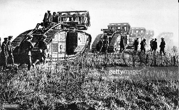 Entente troops are taking the Siegfried line north of St.Quentin towards Cambrai: British Mark IV tanks, carrying fascines to cross ditches, in their...