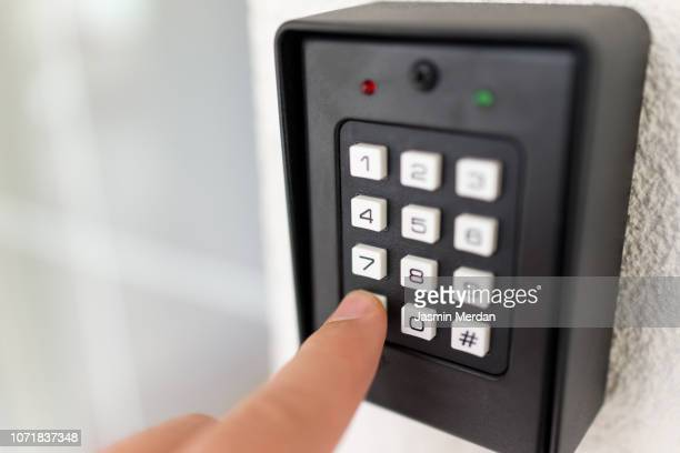 entering door code - intercom stock pictures, royalty-free photos & images