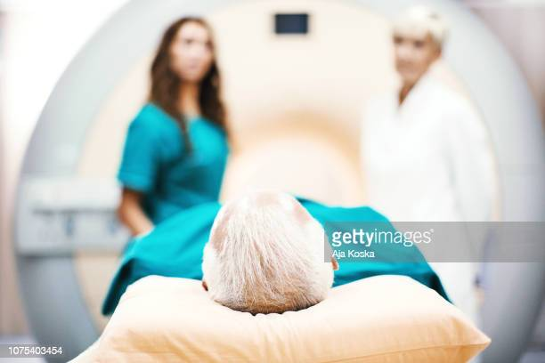 entering mri scan. - old man feet stock pictures, royalty-free photos & images