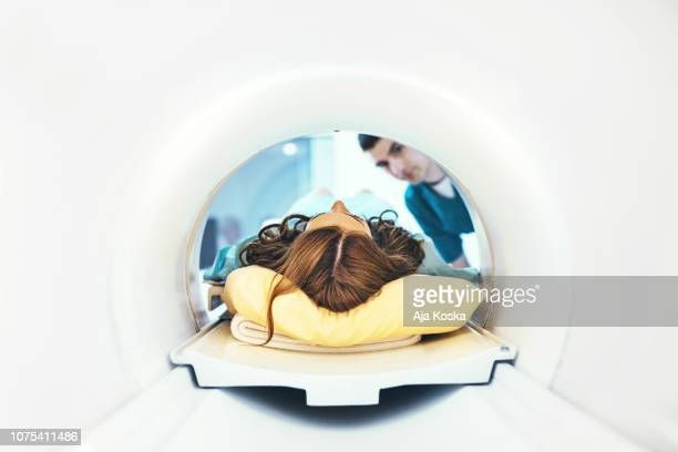 entering mri scan. - head stock pictures, royalty-free photos & images