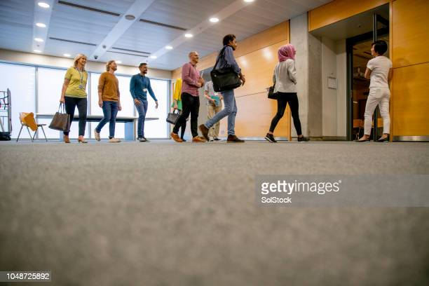 entering the classroom - entering stock pictures, royalty-free photos & images
